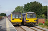 142042 and 144014 pass at Micklefield at 10:10 on Thursday 24th August 2017 with the 2W69 09:52 Selby - Huddersfield and 2K13 09:50 Leeds - Selby respectively.