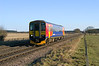 153321 approaches Claxby and Usselby L/C as the 2T51 Newark Northgate - Grimsby Town on Wednesday 3rd April 2013.