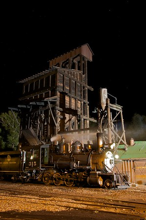 315 stands in front of the 1920's era coal tipple in the Chama Yard.