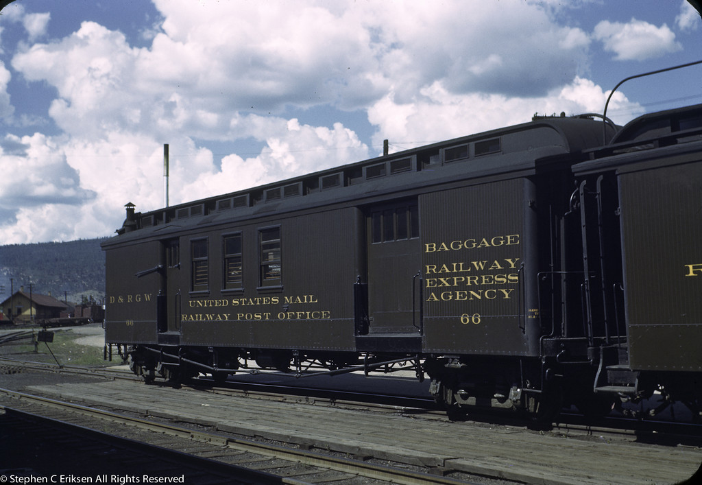 "This 1940's view shows Raliway Express Agency car #66 resplendent in Pullman Green paint at the head end of the ""San Juan"""