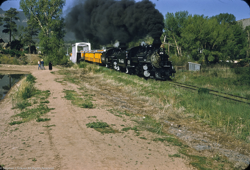 This fan trip on June 1st 1957 features double headed K-28's number 476 and 478 on the head end of the bright yellow consist.