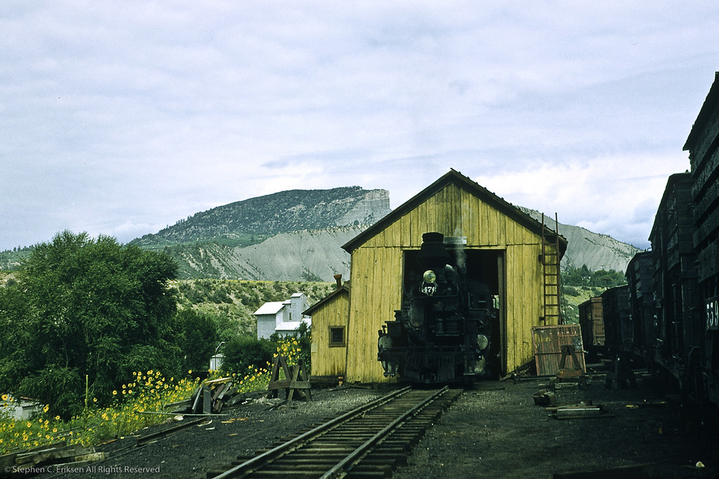 Its August 19, 1957 and check out the antlers on #476 resting in the car shop in Durango!