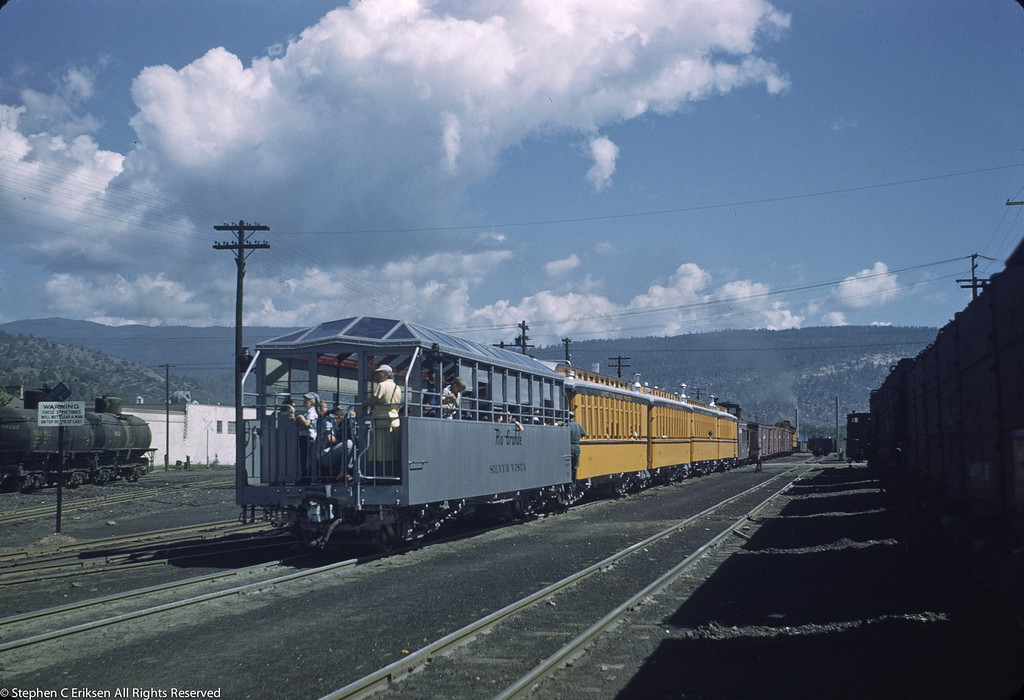 K-28 #473 heads up a mixed train out of Silverton with the Silver Vista bringing up the rear of the train. July 1950.