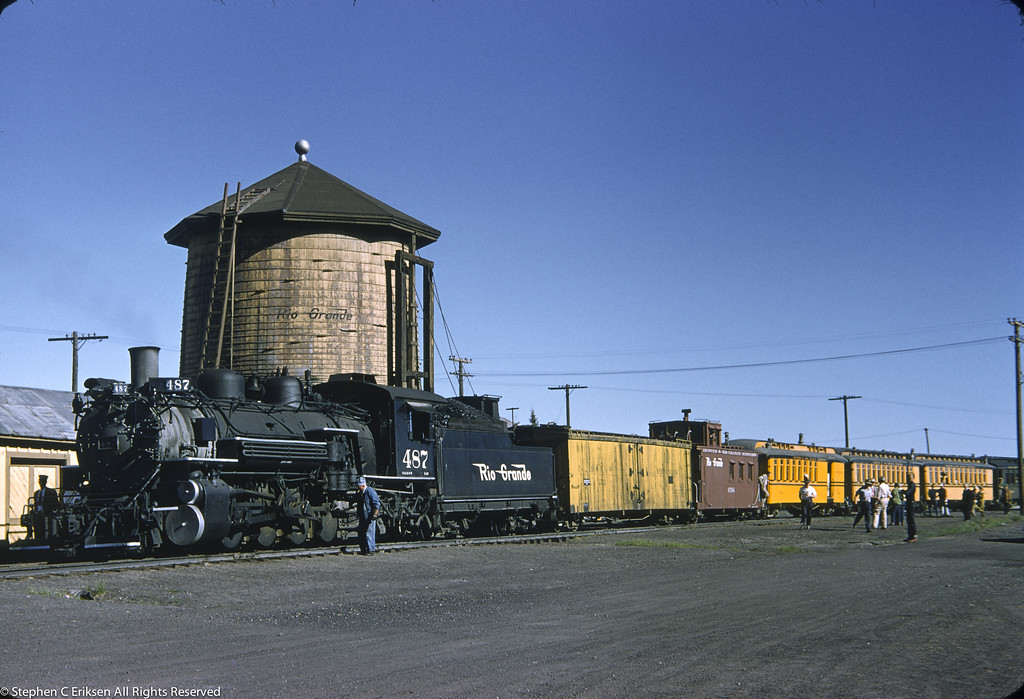 It is May of 1954 and this shot of #487 at Antonito captures the mixed nature of passenger travel at the time with refrigerator car, caboose, combine, and passenger coaches in multiple paint schemes.