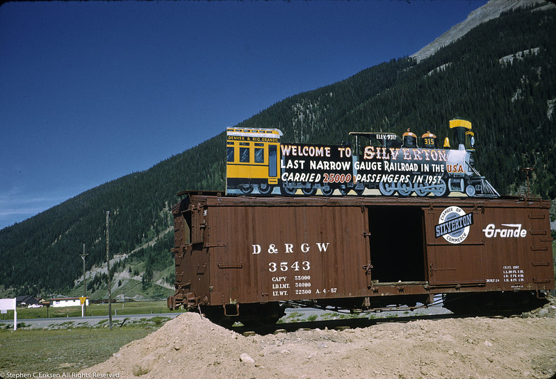 A sign proclaims 25,000 passengers carried in 1957, although this Silverton view was captured in July of 1959.