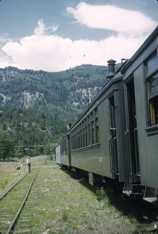 This scene at Rockwood shows the Silver Vista bringing up the rear of the Silverton train.  Note that the coaches are still sporting their Pullman Green paint scheme in this shot taken in the 1950's.