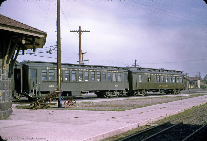 Coach 319 and freshly painted parlor car Durango repose in this view at Antonito, Colorado from August 25th, 1950