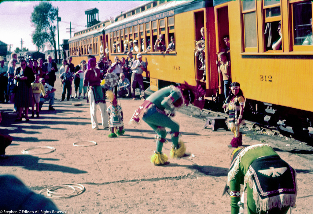 Native Americans entertain the tourists in Durango. August 6, 1959.  The original slide turned red so the color corrections have turned this slide a surreal color scheme.  Blame it on the peyote!