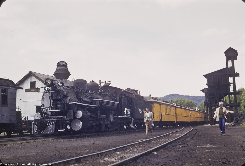Railfan trip is paused in Chama, NM with K-28 #476 at the head end in this shot from 1958.