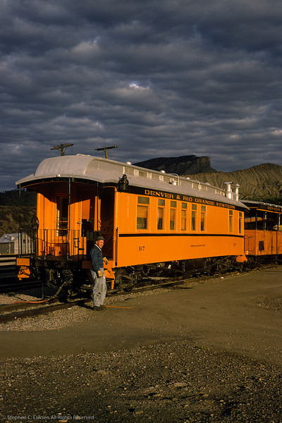 Business car B-7, the General William Jackson Palmer, pauses in the later afternoon sun under darkening Durango skies.  View from June of 1967.