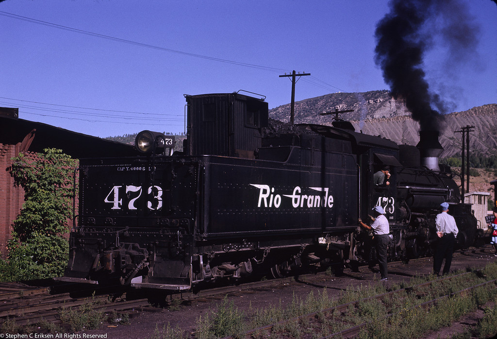 #472 sits under steam next to the roundhouse on August 4th, 1962.