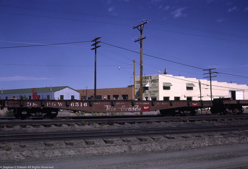Steel flat car 6516 rests in the Alamosa yards in September 1966.