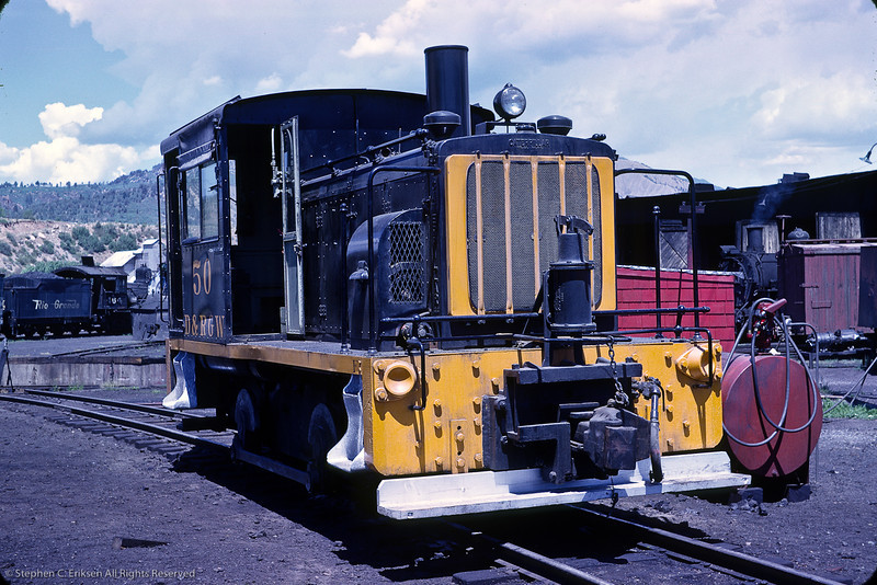 """Diesel #50 is shown in this view near the Durango turntable.  This locomotive has been beautifully restored by the volunteers at the Colorado Railroad Museum. Check out the restoration efforts at  <a href=""""http://www.coloradorailroadmuseum.org/restoration"""">http://www.coloradorailroadmuseum.org/restoration</a>."""