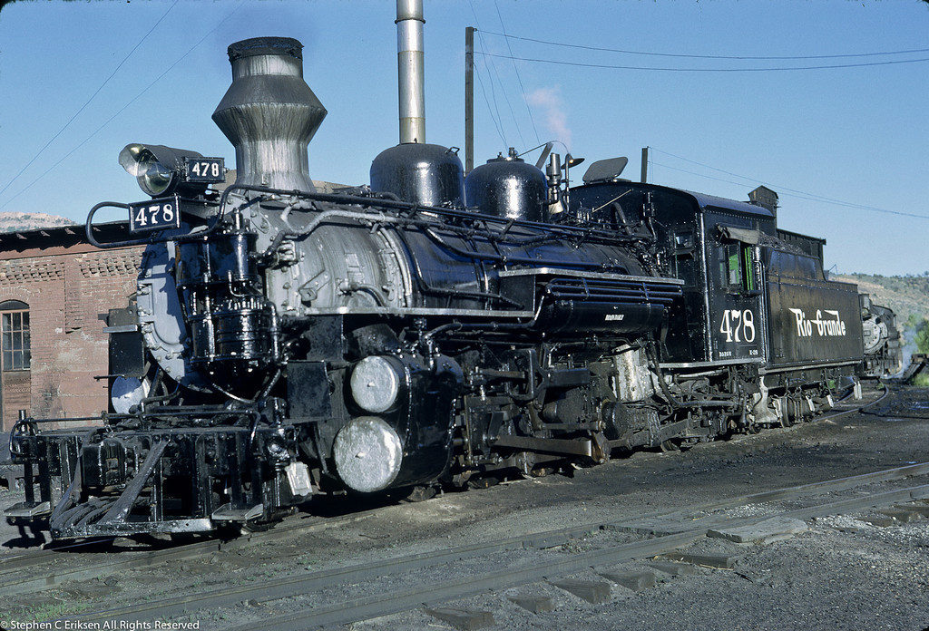 This June of 1962 shot finds K-28 #478 resting next to the Durango roundhouse.  The fake diamond stack has been painted silver at this point in time.