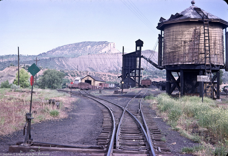 Nice view of the Durango yards including the car shop, coaling tower, and water tank in June of 1963.