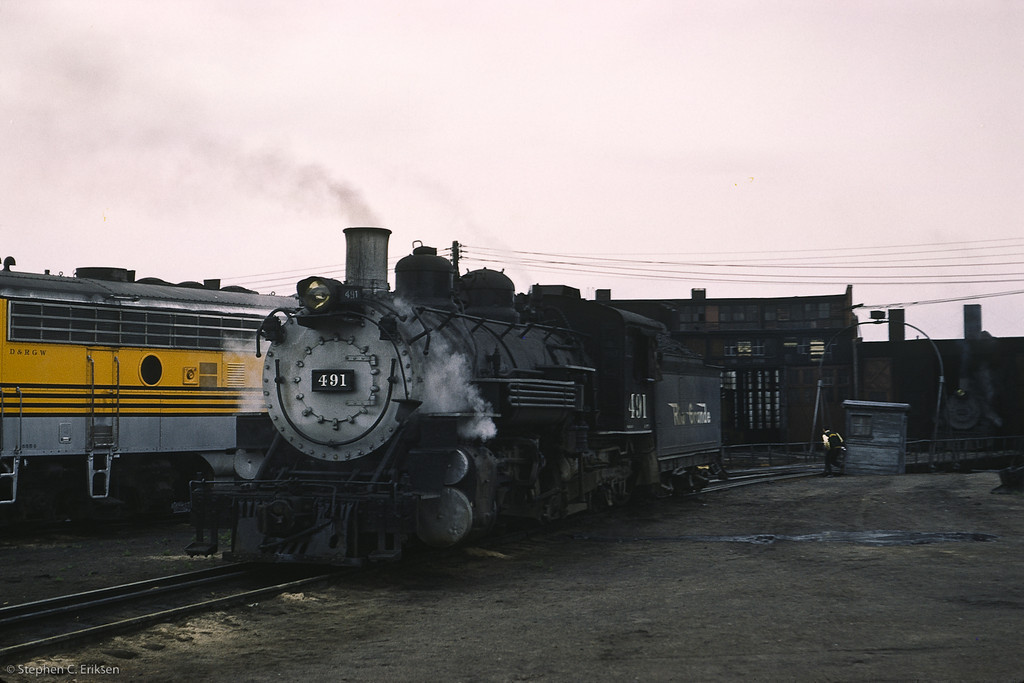 In this view from August of 1961, K-37 #491 rests in Alamosa next to its diesel companion.  Another K-series waits in the wings.