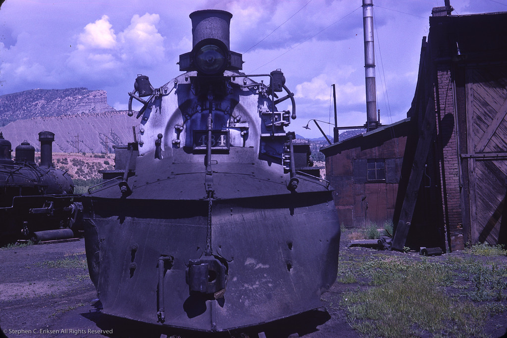 K-36 #484 rests next to the Durango roundhouse with K-27 #464 in the background.  August 1964 photo by Richard Cerne.