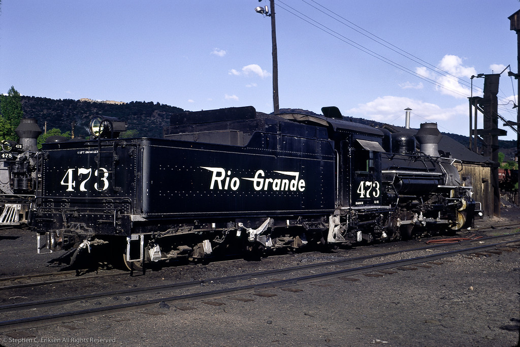 This view from June of 1967 shows #473 in front of the Durango sand house with #478 in the background.  The coaling tower can just be seen at the edge of the view.