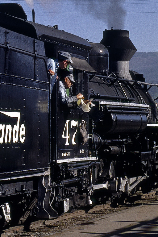 The crew reviews their train orders prior to departure of the Silverton in this view from June 1967.