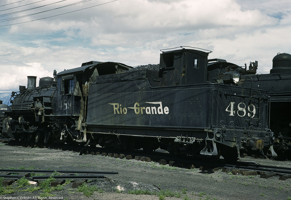 It is June 15, 1961 and here we find K-36 #489 resting in Alamosa amongst its steam powered brethren.