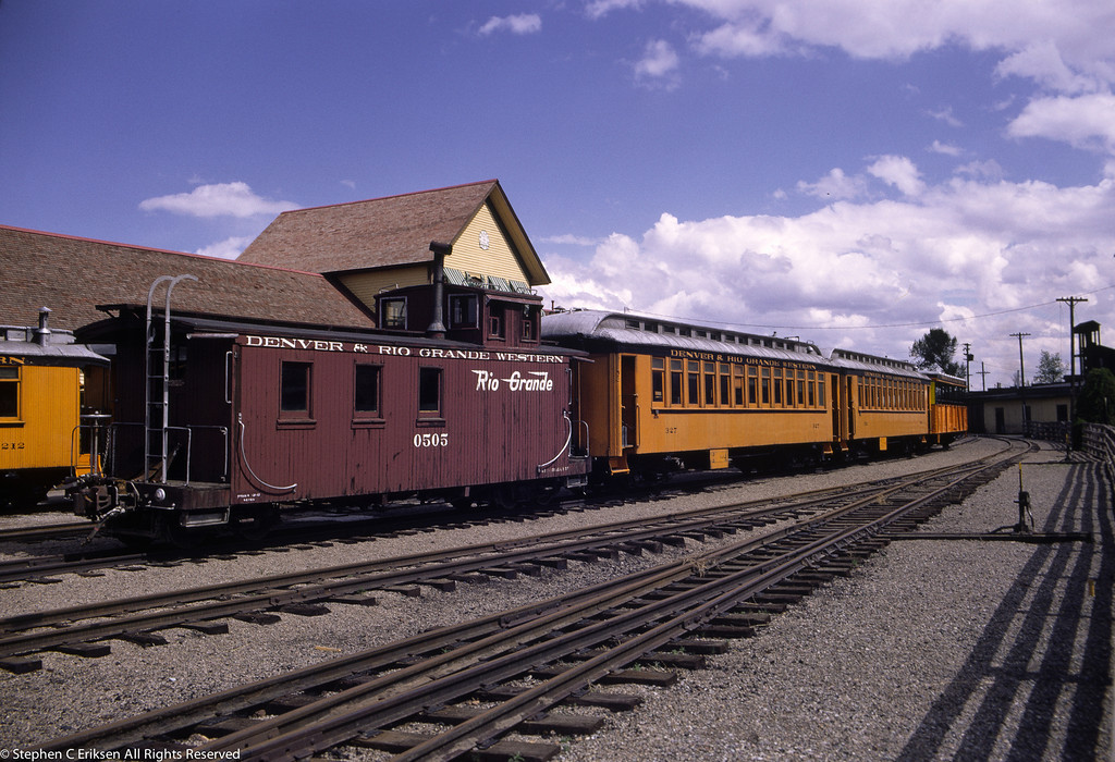 Caboose #0505 and former San Juan coach #327 sit in front of the Durango depot in this shot.