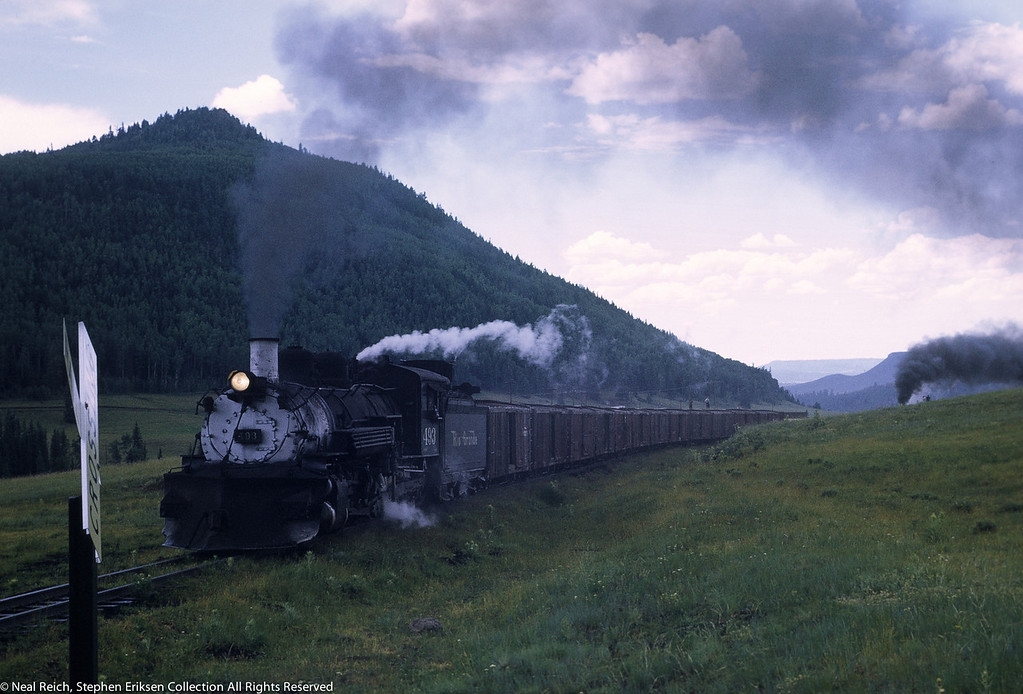 #493 with smoke from #483 visible near Lobo Lodge, NM on July 18, 1968.