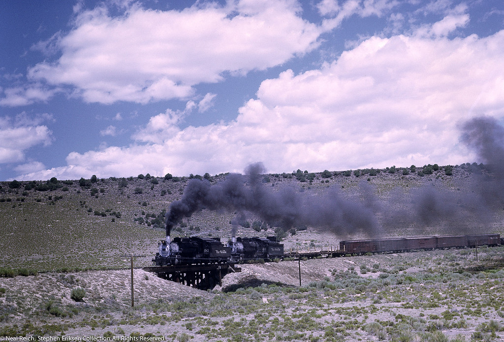 #483 and #493 cross the trestle west of Antonito, CO. near Lava, NM on July 17, 1968.