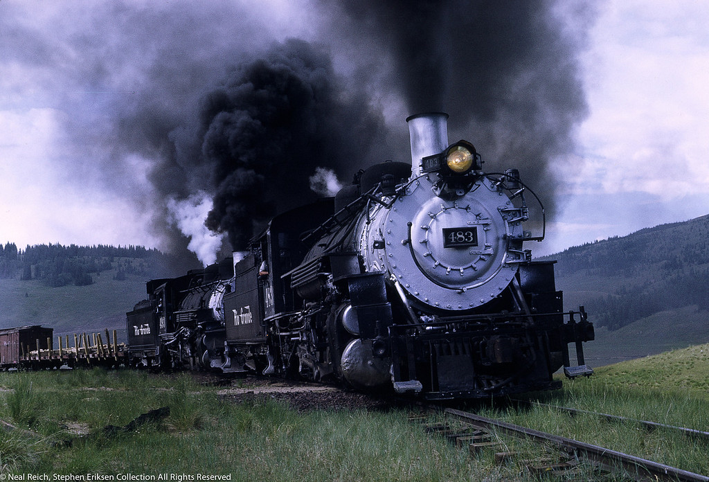 Great view of double header featuring #483 and #493 west of Los Pinos, CO. on July 17, 1968.