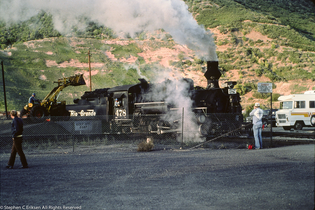 The skip loader fills coal in the tender of 478 in the Durango yards in September of 1976.