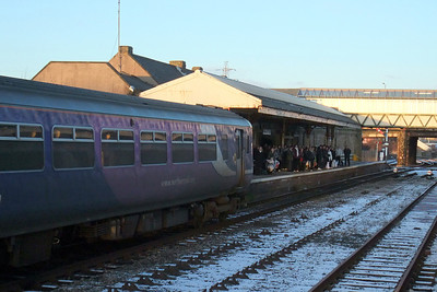 A Class 156 arrives at Workington Main station for the evening rush hour, 06/01/10.