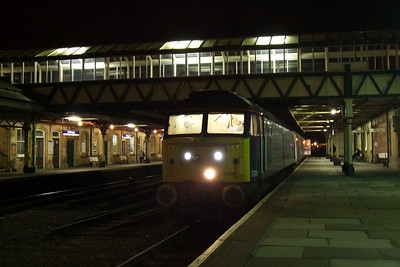 57008 sits at Workington in the dark, waiting for the road, 20/01/10.