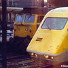 A tantalising half frame photo of set No: 370001 at Crewe next to a Class 47 in the summer of 1980. Who would have thought that the Class 47 would outlive the APT?<br /> This was one of those Murphy's Law events when this frame happened to be the last one of the film!
