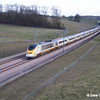 An Up service passes Boardley Farm on 8th March 2004