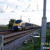 On 14th October 2004 a GNER Eurostar passes Tempsford Crossing north of Sandy with a Down ECML service for Leeds
