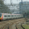 A Pendolino set heads north at Rugeley on 23rd April 2010