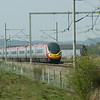 Unidentified class 390 approaching the site of Hixon Level Crossing on 23rd April 2010. This was the scene of a fatal accident on 6th January 1968 when a low-loader  carrying a 120-ton electrical transformer was was crossing the line and was struck by an InterCity express train. Eleven people (eight passengers and three railwaymen) were killed, with 45 being injured; six of them seriously. The crossing was replaced by a bridge in 2002