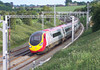 A Down Pendolino service leans to the curve at Dodmoor Road, north of Weedon, on Friday afternoon 17th June 2005