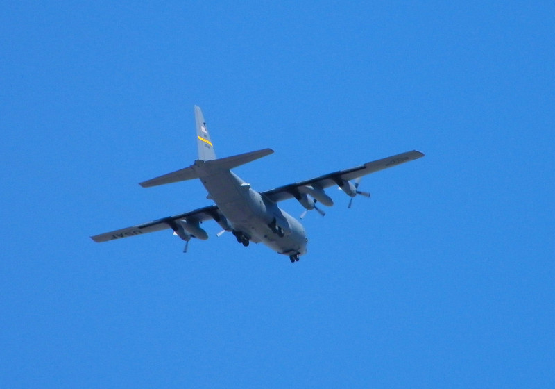 Lockheed C-130 (Air Force or ANG) doing touch-N-goes around inner upper south northern Cheyenne.