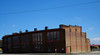 Backside of curved building that houses U.P. steam shop and overall restoration operations.  It's across several tracks of the large marshaling yard at Cheyenne, easily visible - if no freights are sitting in the way - from the old depot.