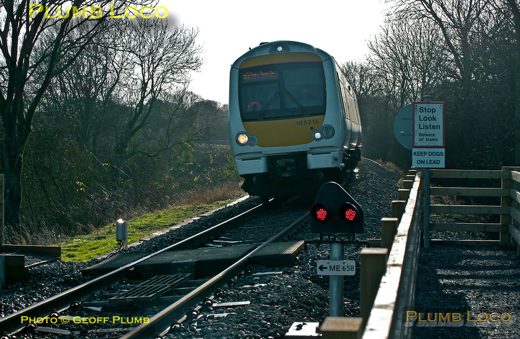 168 215 is working the 12:07 train from Marylebone to Birmingham Snow Hill, here at the foot-crossing over the down line just south of Princes Risborough at 12:38 on Thursday 22nd December 2011. Digital Image No. GMPI10702.