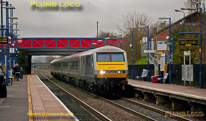 """On Friday 23rd December 2011, Chiltern ran some extra loco-hauled services for the great Christmas getaway. Here, 82303 leads 1R30, the 12:37 from Marylebone to Birmingham Moor Street, with 67013 """"Dyfrbont Pontcysyllte"""" on the rear of the set. The train is passing through Haddenham & Thame Parkway station at 13:12 as the light deteriorates even further - it became too bad to see any of the later extras! Digital Image No. GMPI10725."""