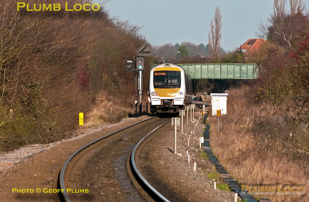 168 215 is working the 12:07 train from Marylebone to Birmingham Snow Hill, having just passed milepost 24 (from Northolt Junction) is now passing signal ME159 with a clear green aspect as it descends the 1 in 88 gradient on the down line just south of Princes Risborough at 12:38 on Thursday 22nd December 2011. Digital Image No. GMPI10703.