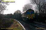 "Freightliner 66553 is aproaching Princes Risborough with 6M22, the 08:16 from Cricklewood to Calvert ""binliner"" train at 12:29 on Thursday 22nd December 2011, a rather awkward time of day for the light! Photo taken from a public footpath across the line. Digital Image No. GMPI10695."