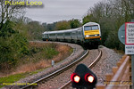 "Chiltern ran some extra Loco-hauled services on Friday 23rd December 2011, though this is one of the normal services. 82305 leads 1R14, the 08:37 from Marylebone to Birmingham Moor Street, with 67012 ""A Shropshire Lad"" providing the power on the rear. The train is approaching Princes Risborough on the 1 in 88 descent from Saunderton summit, where the up and down lines are grade separated. The ground signal in the foreground denotes the limit of shunt on the down line from Princes Risborough. 09:05 on a very dull morning - it didn't get any better throughout the day! Digital Image No. GMPI10718."