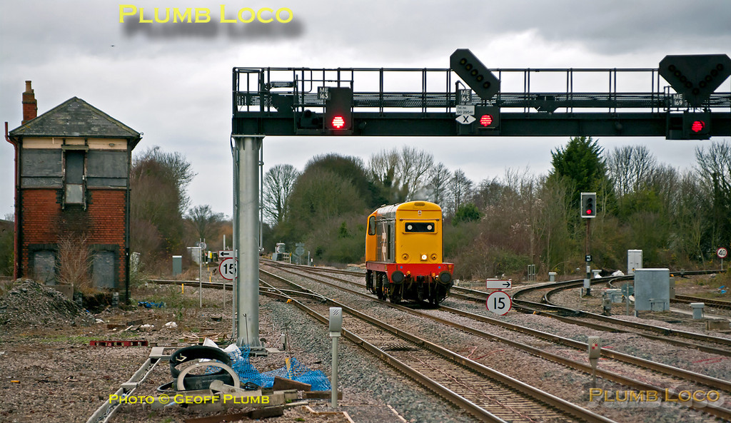 Running light engine as 0Z20, Class 20 Bo-Bo No. 20227 looks rather lost amongst the infrastructure as it approaches Princes Risborough on the new through line, working from Bescot to West Ruislip. The trip should have comprised two locos, but the other was unavaialble, meaning this loco unusually ran nose first. 13:50, Thursday 29th December 2011. Digital Image No. GMPI10733.
