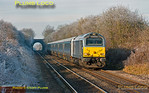 "At one minute past mid-day the sun has reached its zenith but the frost formed by freezing fog the previous day and overnight still has not melted as 67013 ""Dyfrbont Pontcysyllte"" races southwards approaching Haddenham and Thame Parkway station with DVT 82303 on the rear of the six coaches. This is 1H44, the 10:55 from Birmingham Moor Street to Marylebone on Wednesday 12th December 2012. This set is still the ""wrong"" way round at the moment with the loco on the south end, though this helps for photography! Digital Image No. GMPI13247."