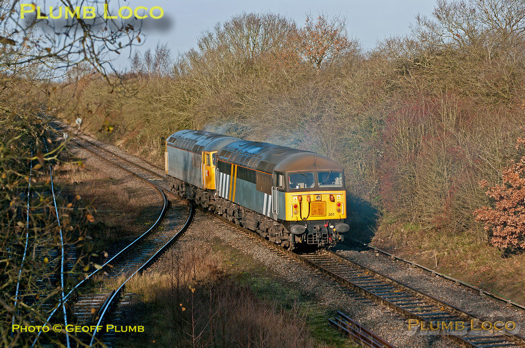 56312 has been the regular loco working 6Z92 and the return 6Z91 fly ash trains from Didcot Power Staion to Calvert. After the train was unloaded at Calvert on Monday 3rd December 2012, 56312 failed whilst the train was in the loop at Claydon L&NE Junction. 56301 was on its way to Eastleigh and was diverted to rescue the train, though exactly what happened I'm not sure. Seen on Tuesday morning at Calvert at 11:04, 56312 is leading 56301 as they move along the main running line from south of the unloading gantry to collect the train from Claydon. 4th December 2012. Digital Image No. GMPI13096.