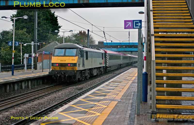 "In miserable light and pouring rain, the unusual sight of the ""Pretendolino"" set on the East Coast Main Line as it passes northbound through Brookmans Park station. This was 1Z90, 14:21 from King's Cross to Wakefield Westgate, a football charter train for Chelsea fans. DVT 82126 is leading with 90044 on the rear. 14:40, Wednesday 19th December 2012. Digital Image No. GMPI13289."