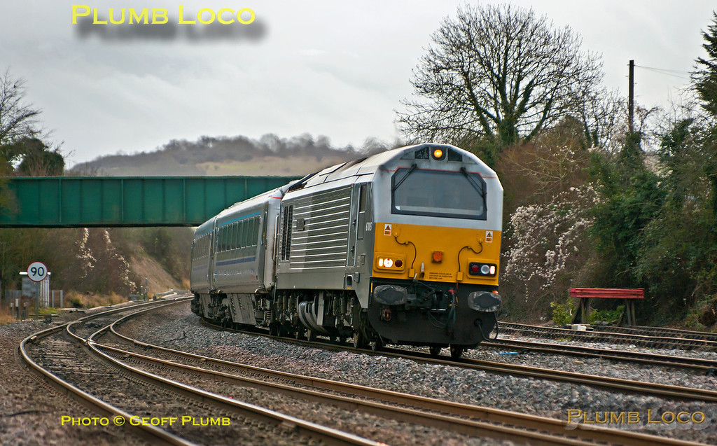 """Coming down the grade from Saunderton summit and entering Princes Risborough is 67015 """"David J. Lloyd"""" at the head of 1R34, the 13:33 from Marylebone to Birmingham Moor Street, running a couple of minutes early at 14:00 on Sunday 23rd December 2012. Digital Image No. GMPI13367."""