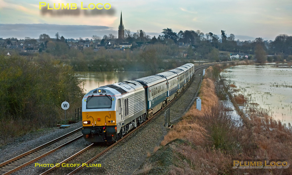 """On the winter solstice and with the Earth still in existance, Chiltern ran some trains using LHCS vice 168 units. One such was 1R38, the 14:15 from Marylebone to Birmingham Moor Street, using the """"Banbury Set"""". This has 67010 on the north end of six blue/grey Mk.3s with DVT 82304 on the rear and is seen crossing the River Cherwell flood plain at King's Sutton at 15:11, running around eight minutes late. Friday 21st December 2012. GMPI13301."""